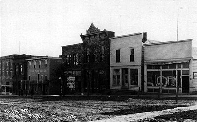 The west side of main street looking south from the top of the hill in the early 1900s.